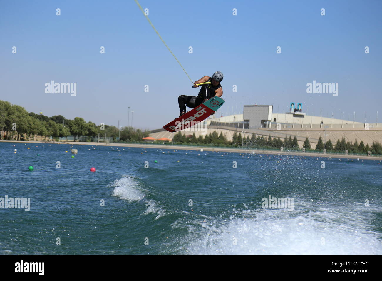 Wakeboarding tail grab - Stock Image