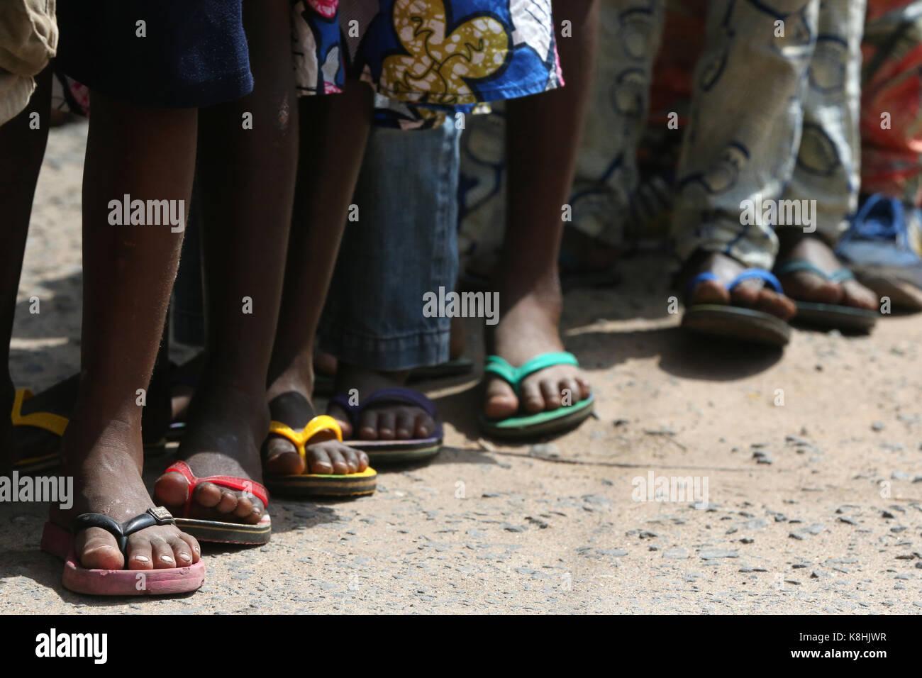 Primary school in africa. schoolchildren wearing corlored flip-flops. lome. togo. - Stock Image