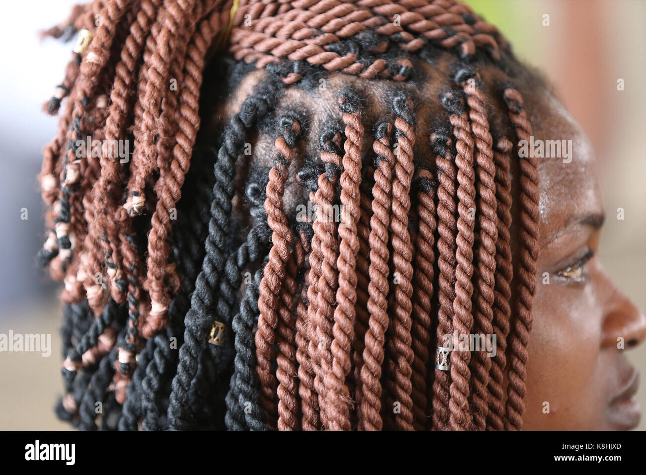 African woman with braided hair lome. togo. - Stock Image