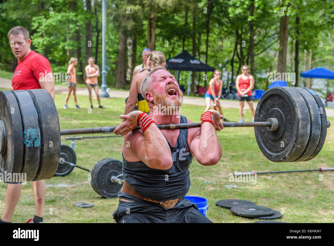Man lifting weights during the Combat on the Coosa competition which is affiliated with The Garage Games and is - Stock Image