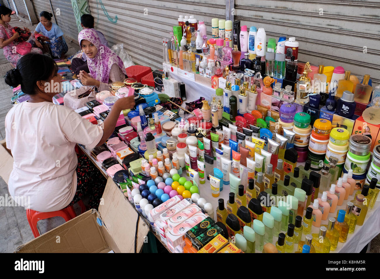 Burma, Myanmar: peddler selling beauty products in a street of Stock