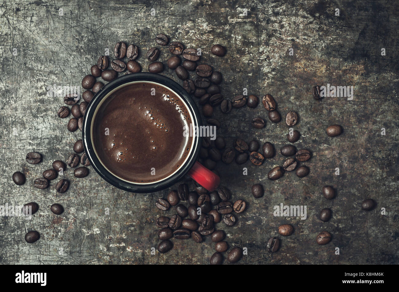 Coffee cup with roasted beans on stone background, from above - Stock Image