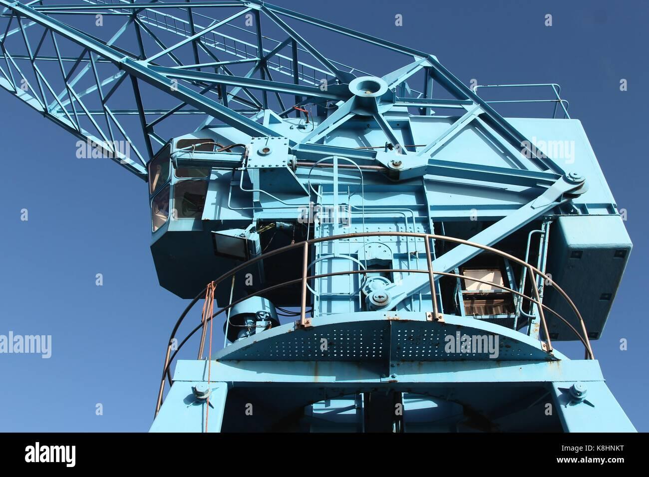 industrial crane against blue sky - Stock Image