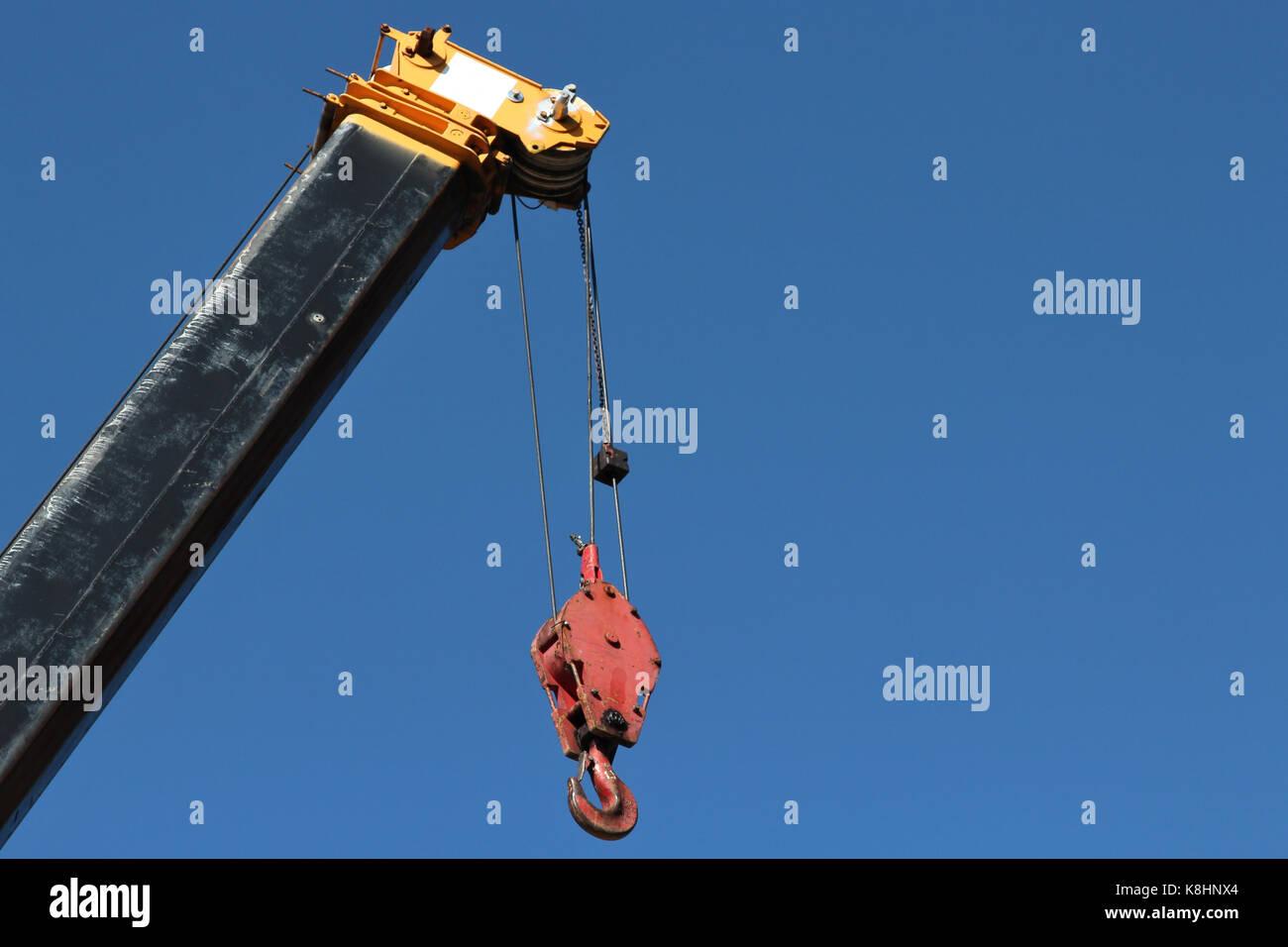 telescopic crane against blue sky - Stock Image