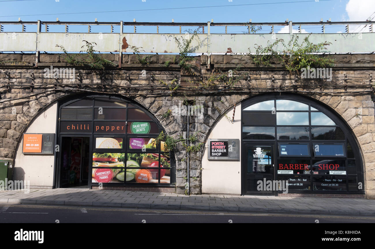 Businesses within railway arches in Forth Street, Newcastle, north east England, UK - Stock Image