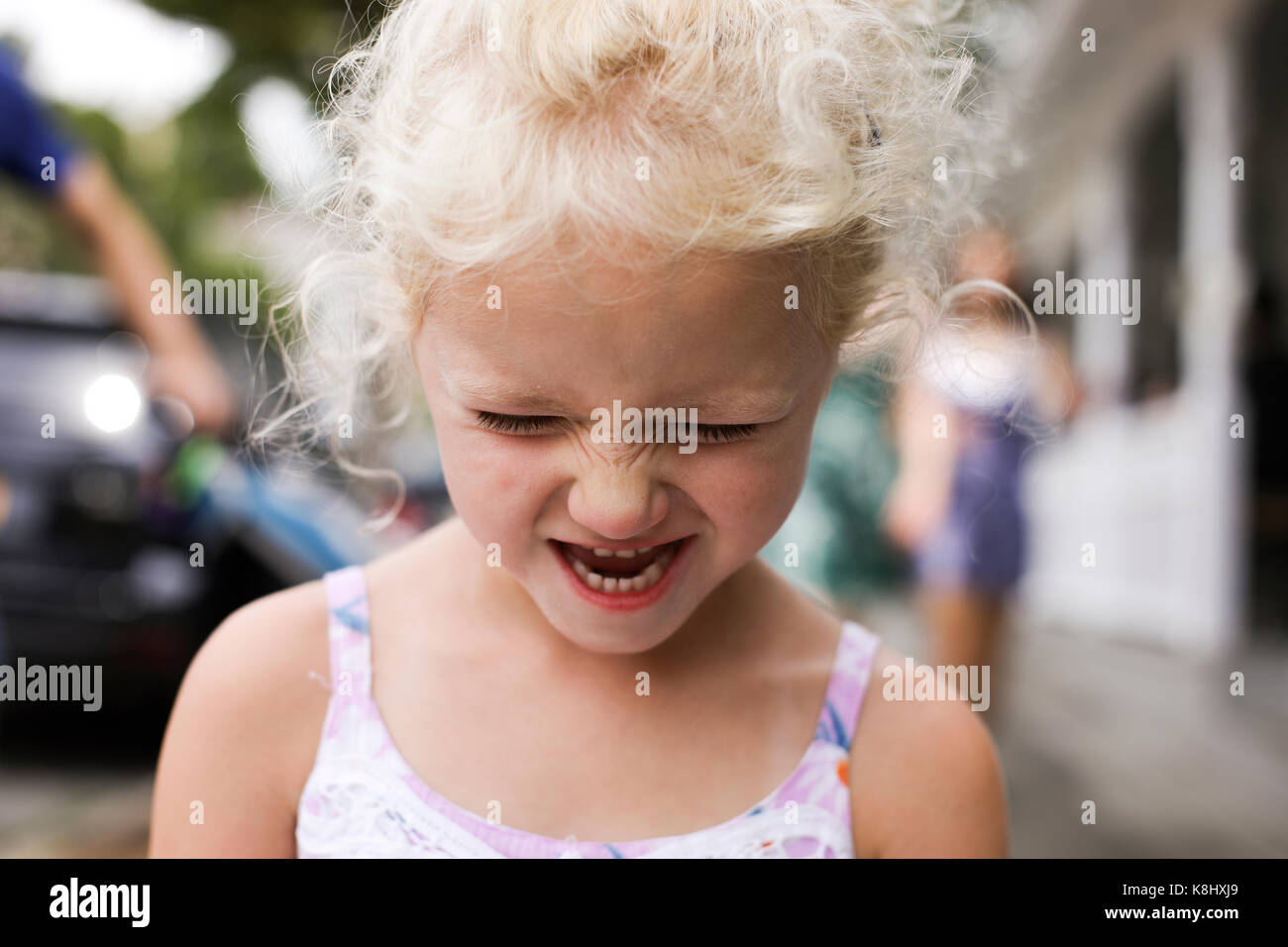 Close-up of girl making face - Stock Image