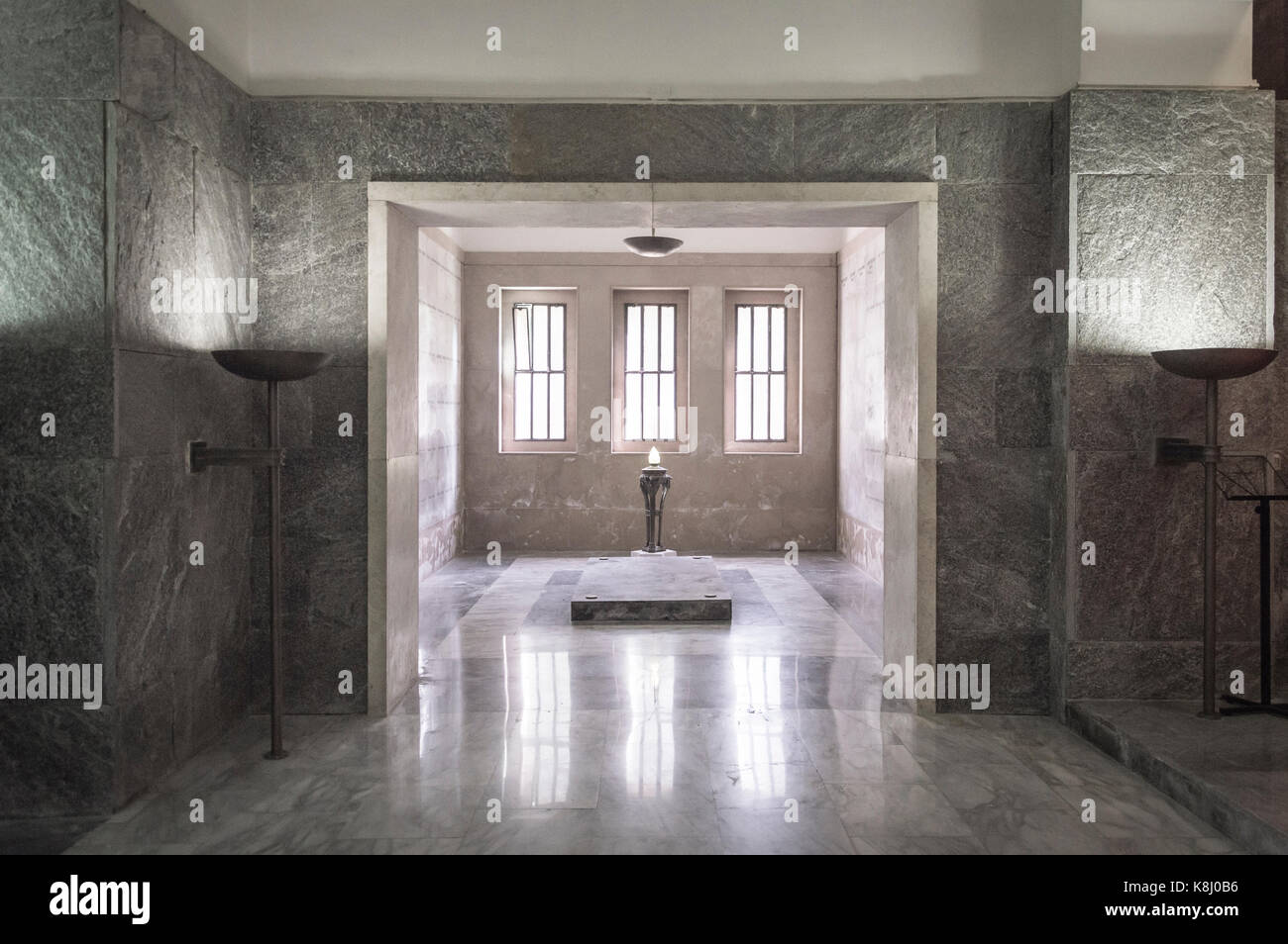 Haunted marble room, with an electric candle in the middle - Stock Image