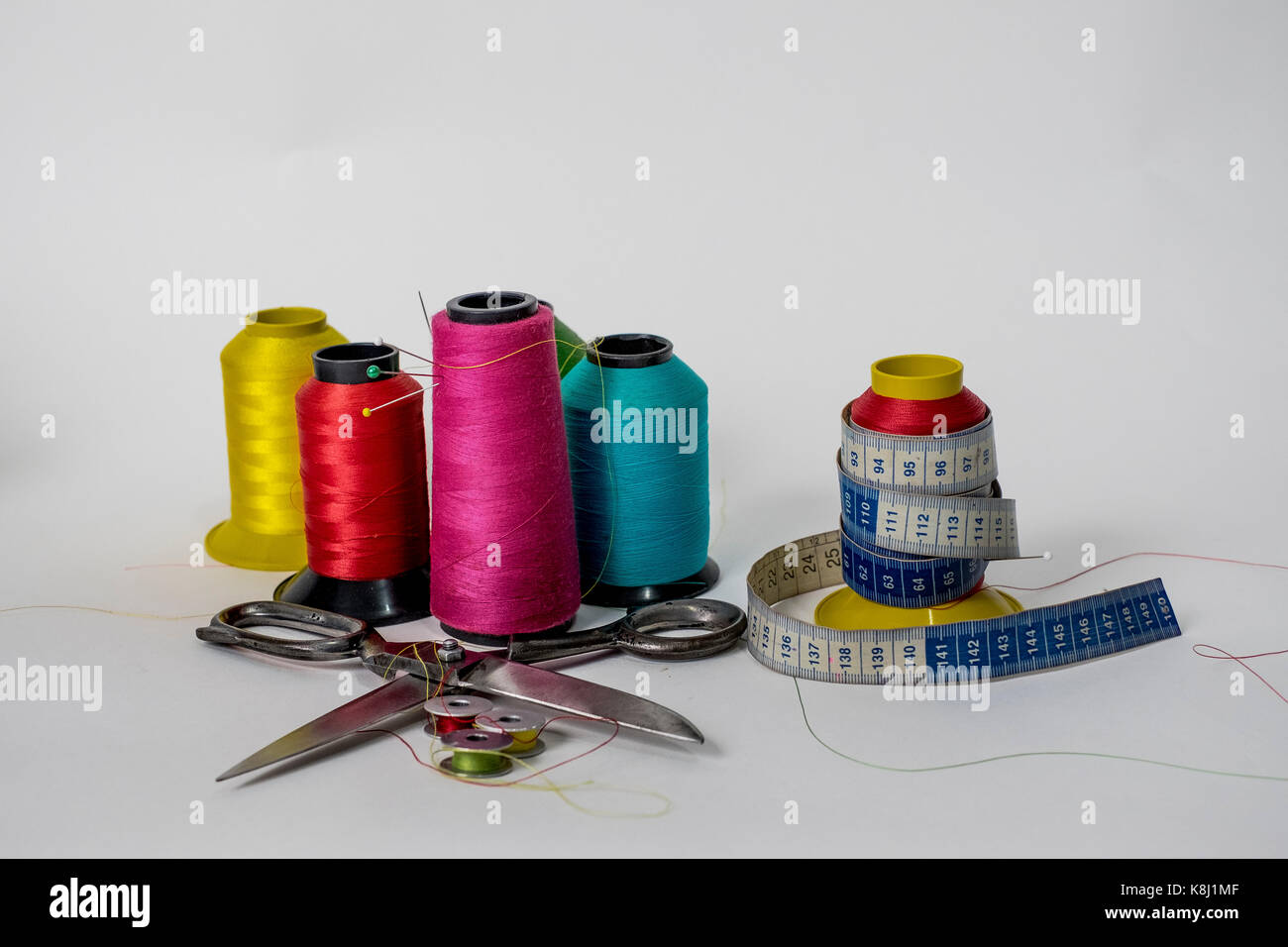 line reels, scissors, metric tape, pin and needles, some of the many necessary tools  for the art of sewing that Stock Photo