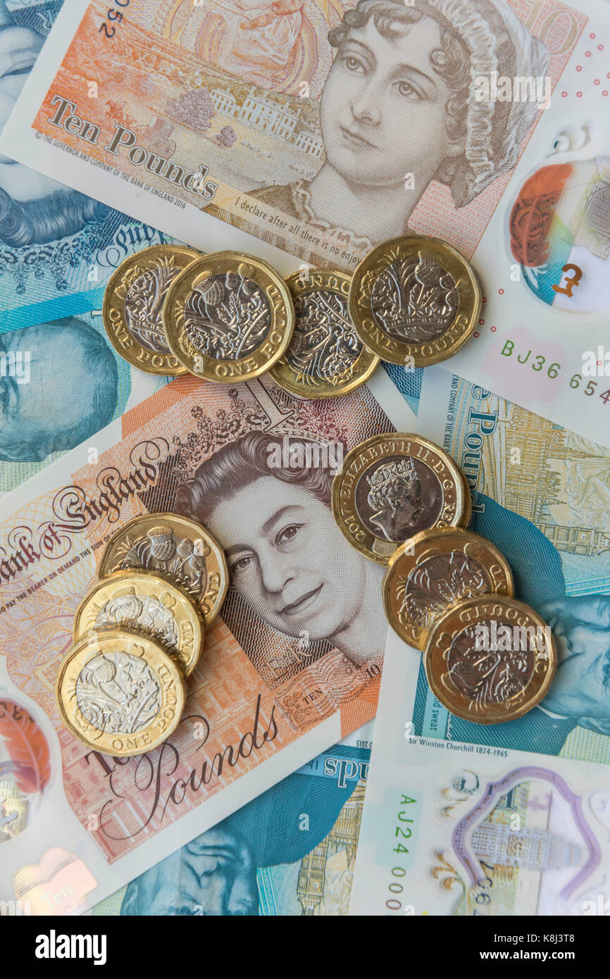 New British currency (one pound coins, five pound and ten pound notes, London, England, United Kingdom Stock Photo