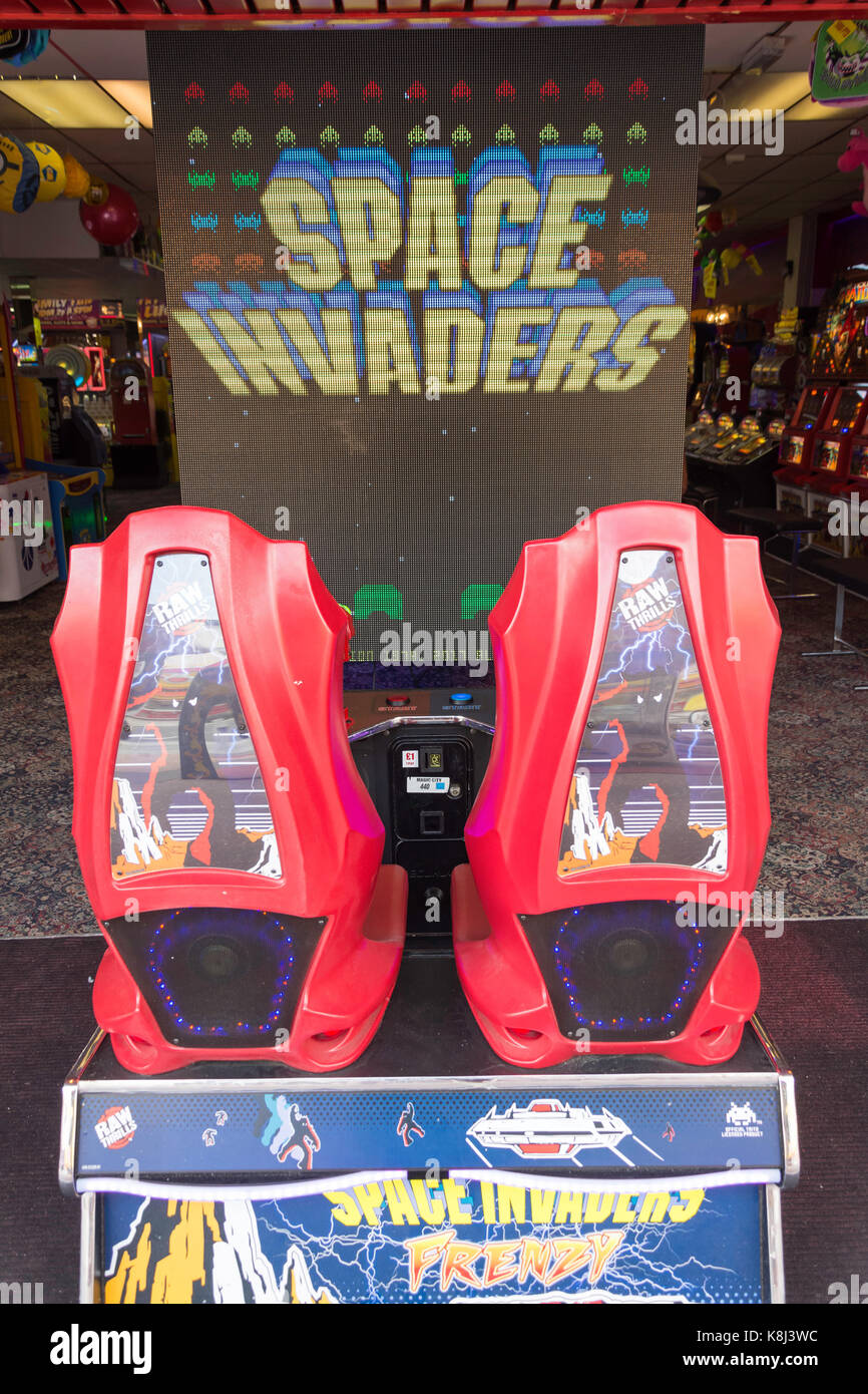 'Space Invaders' retro video game in amusement arcade, Pier Avenue, Clacton-on-Sea, Essex, England, United - Stock Image
