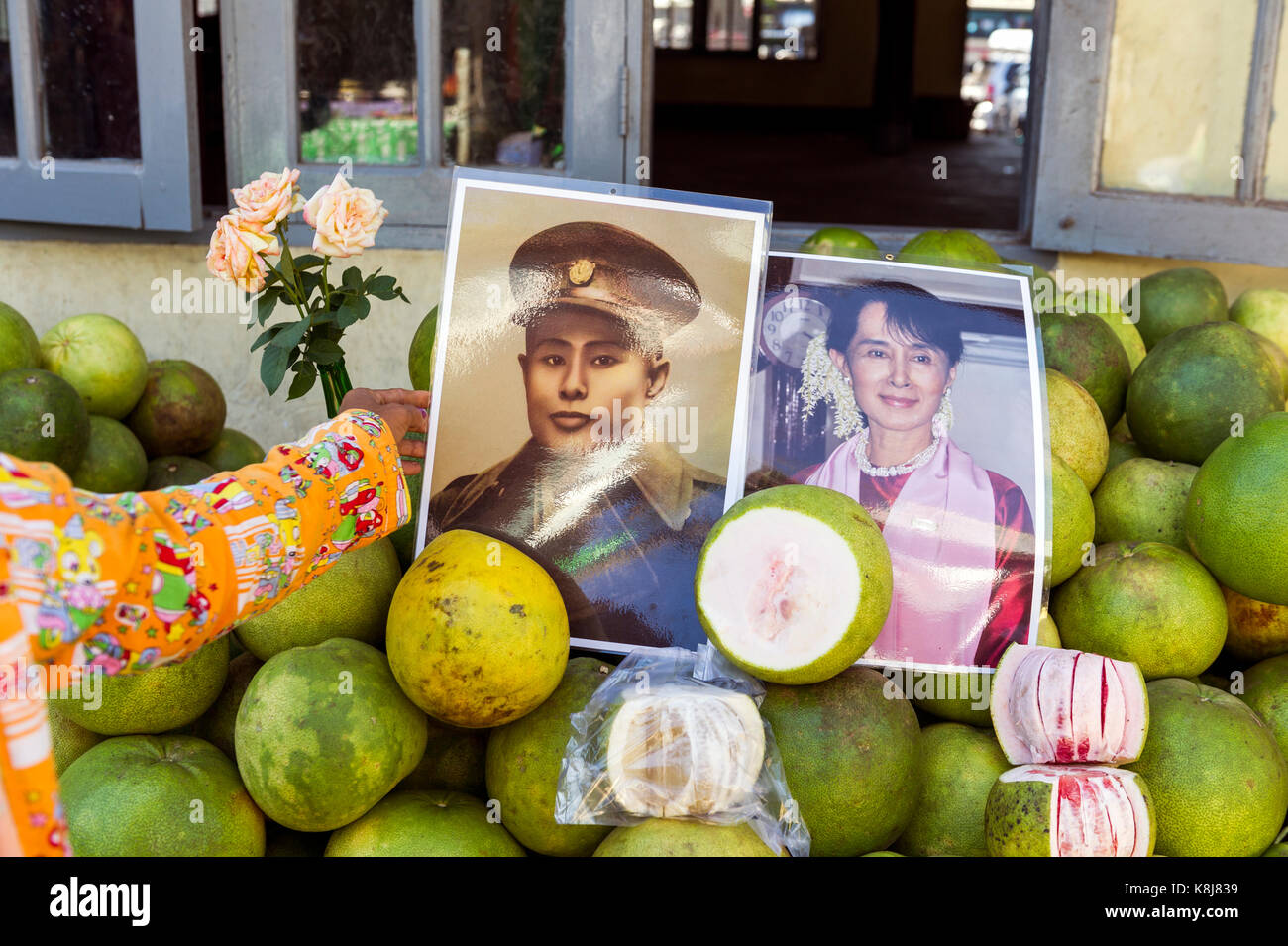 Myanmar (formerly Burma). Kyaiktiyo. State Mon. Photograph of a portrait of Aung San Suu Kyi and her father General - Stock Image