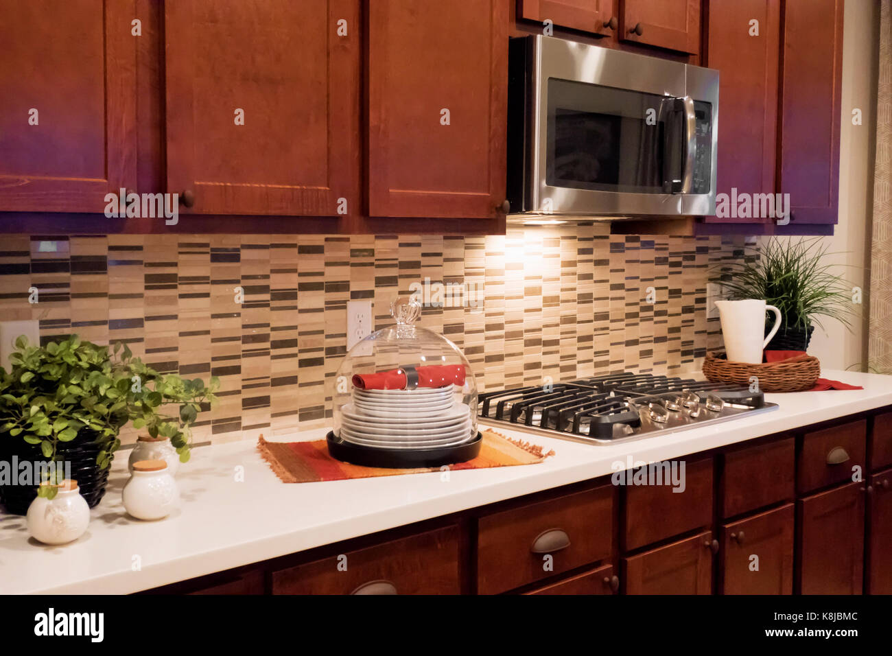 - A Kitchen Countertop With A Stove Top, Microwave With A Beautiful