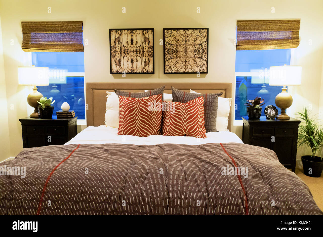A Large Red And Grey Themed Master Bedroom With Nightstands And Stock Photo Alamy