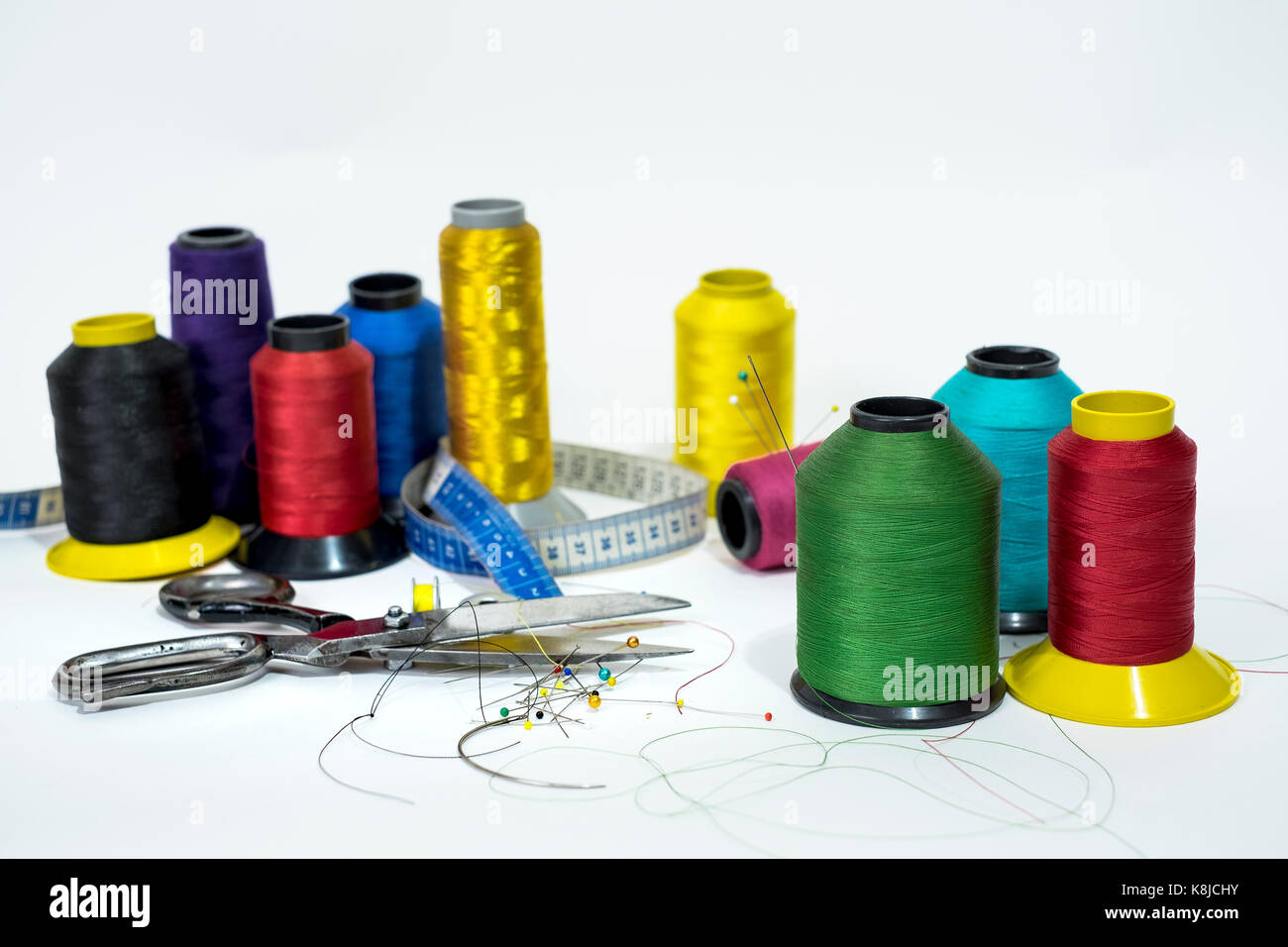 line reels, scissors, metric tape, pin and needles, some of the many necessary tools  for the art of sewing that - Stock Image
