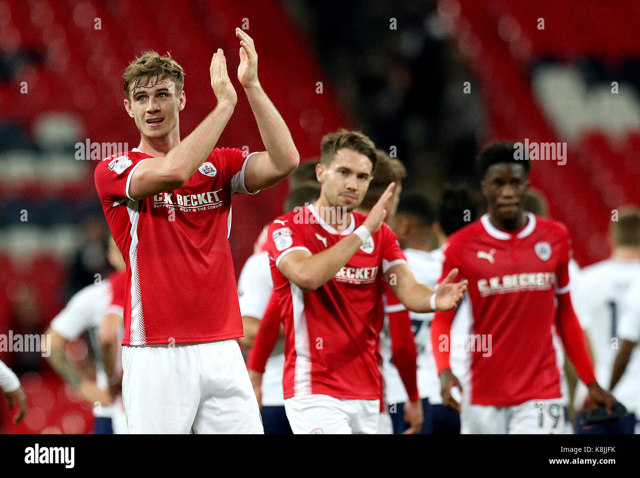 Barnsley's Liam Lindsay (left) acknowledges the fans after the final whistle in the Carabao Cup, third round - Stock Image