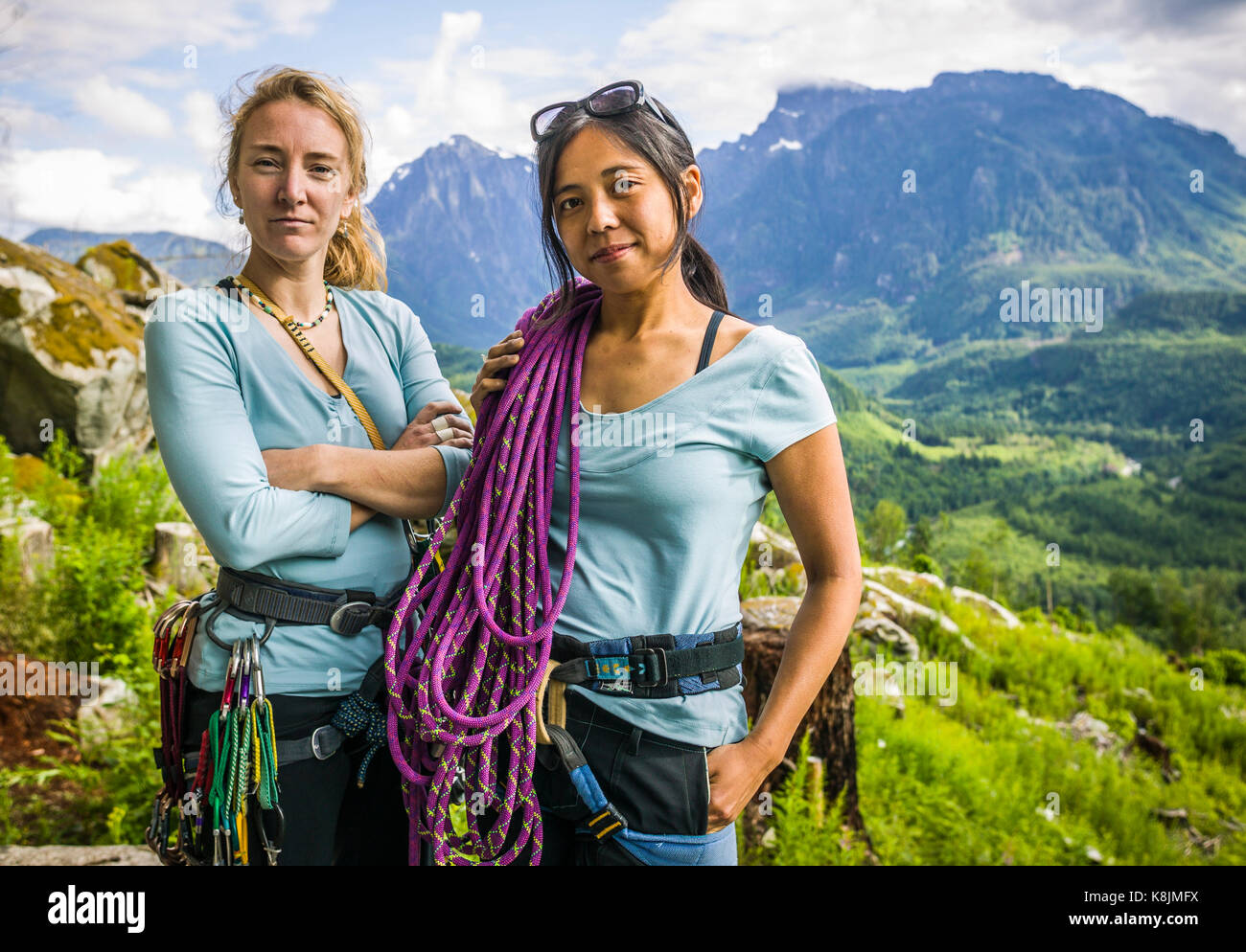A portrait of two women rock climbers ready to go climbing,the Washington State Cascades, USA - Stock Image