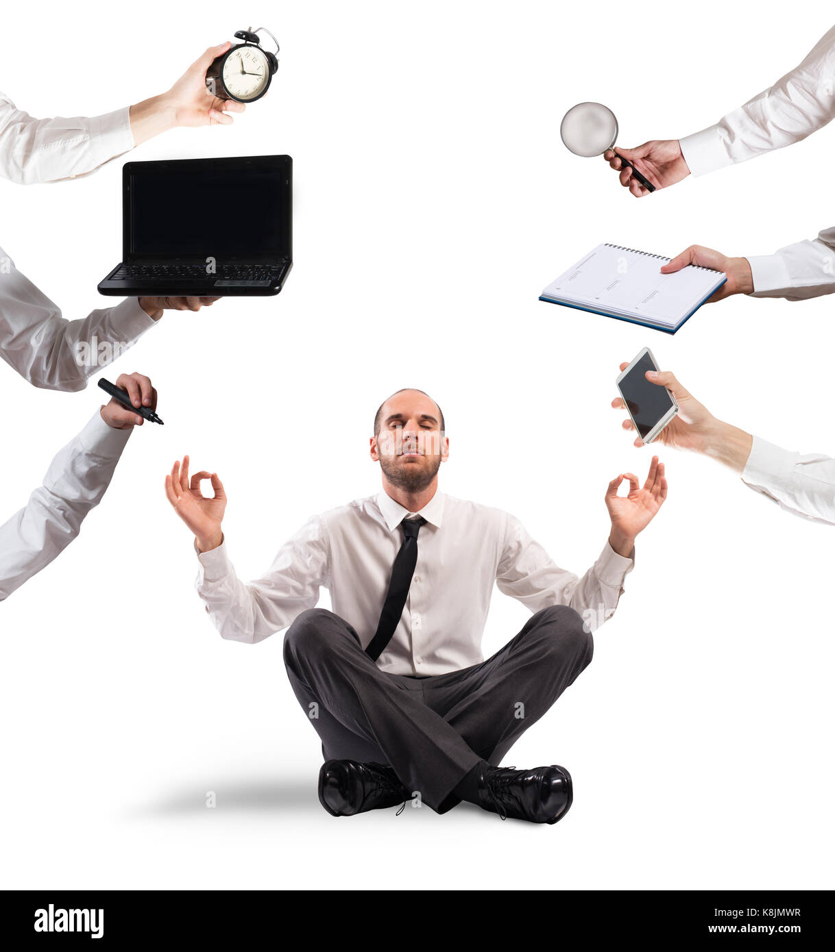 Relaxed businessman that does yoga during the work - Stock Image