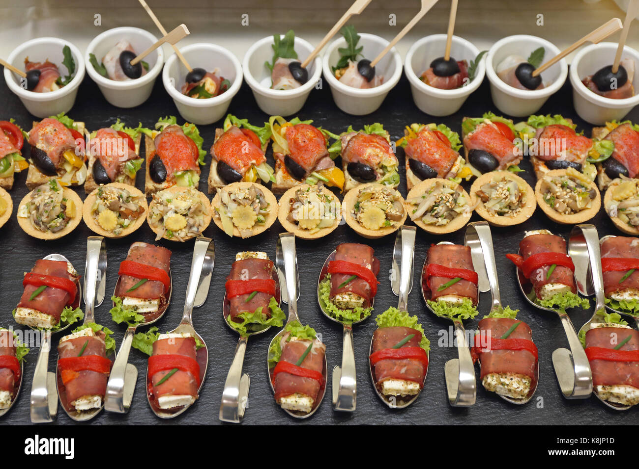 Canape Party Food Served in Bended Spoons - Stock Image