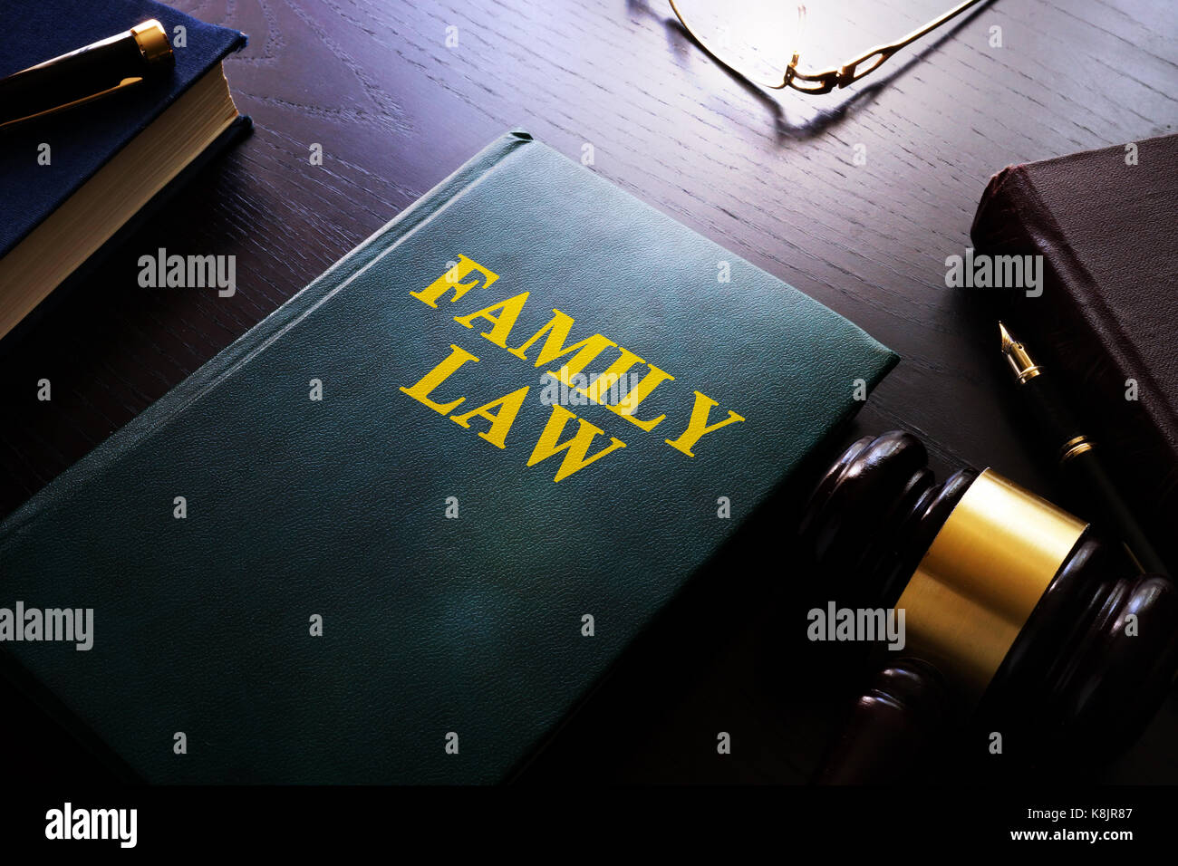 Family law on a table. Child custody and divorce concept. - Stock Image