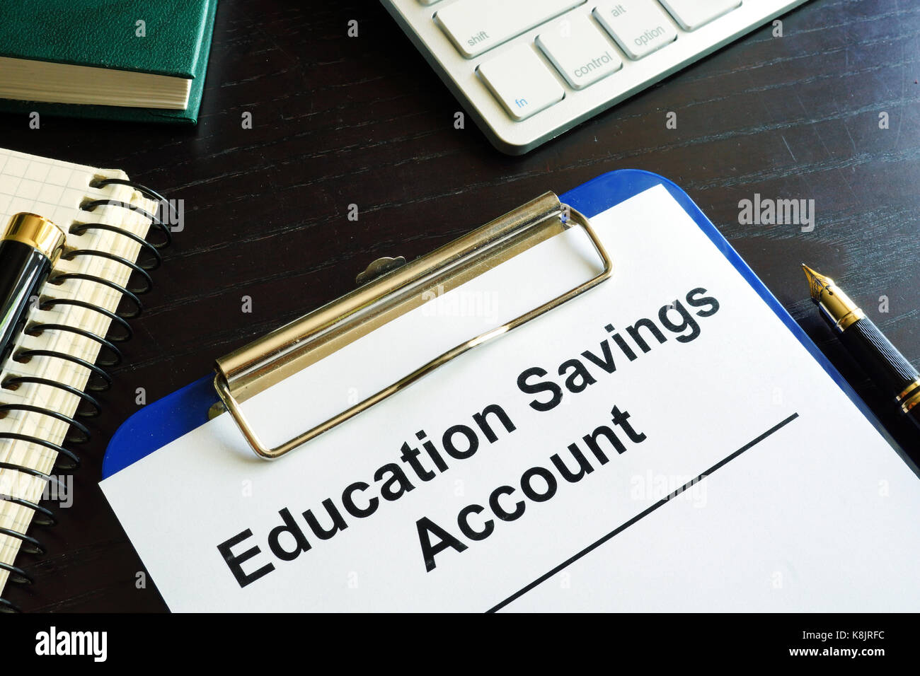 Education savings account ESA form in a clipboard. - Stock Image