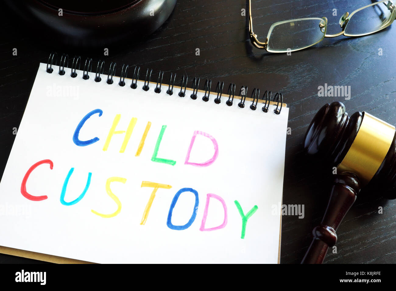 Child custody written in a note and gavel. Separation concept. - Stock Image