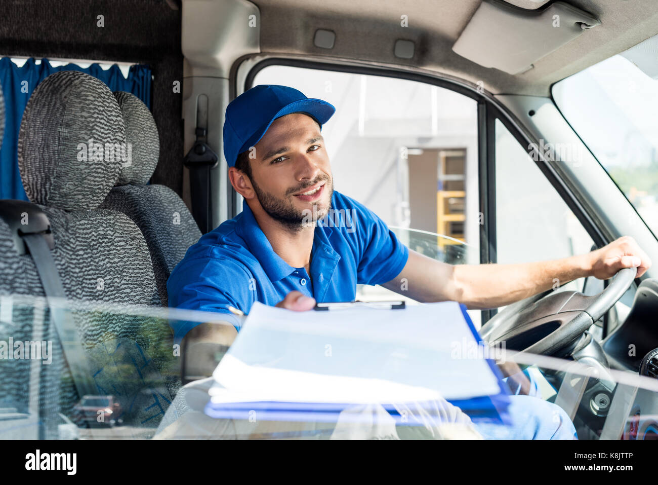delivery man with clipboard - Stock Image