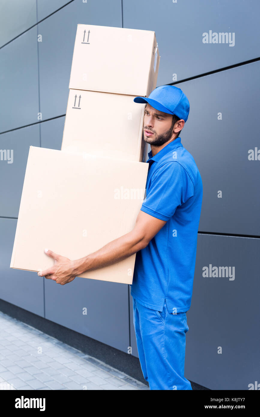 delivery man with boxes - Stock Image
