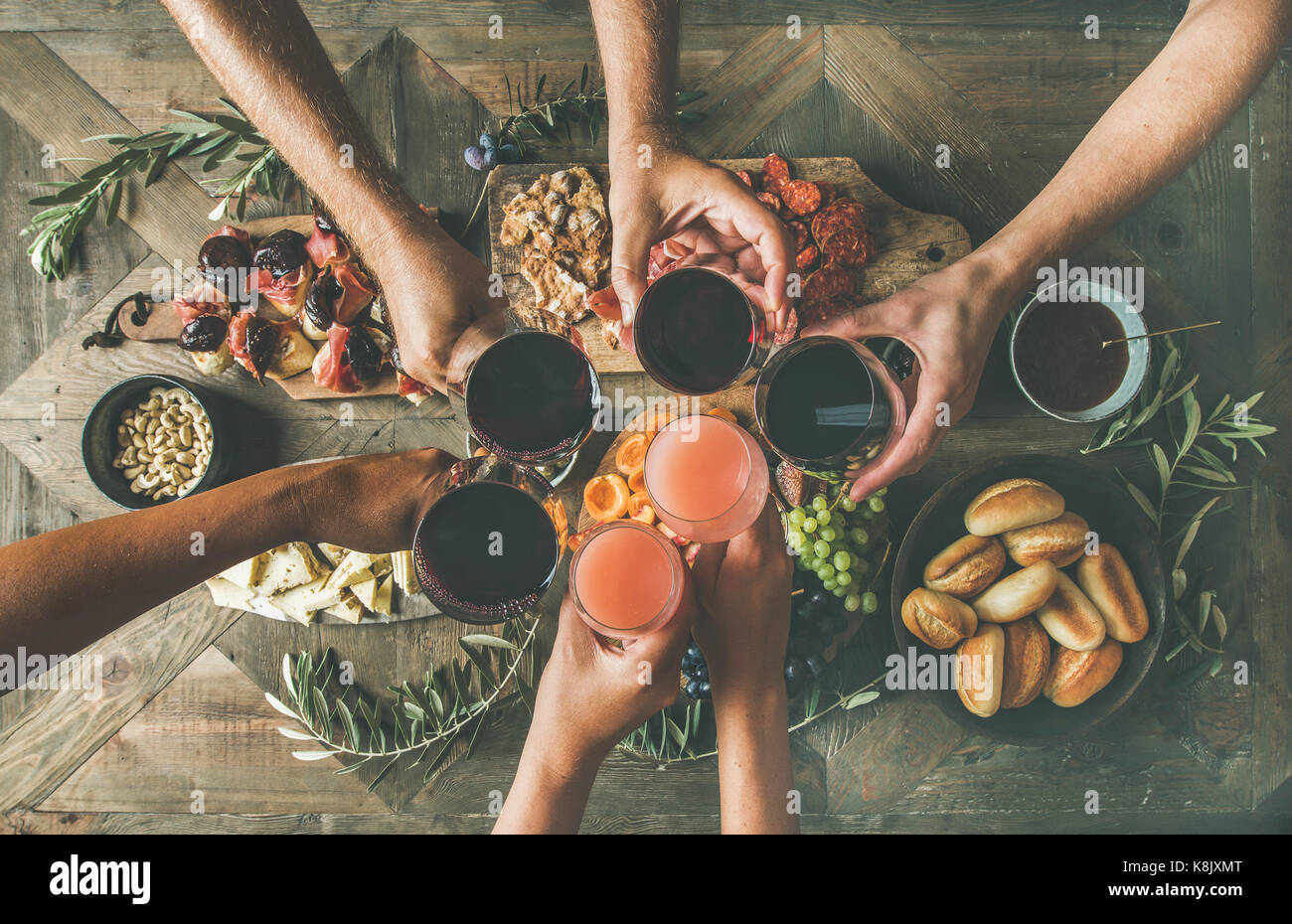 Flat-lay of friends eating and drinking together, top view - Stock Image