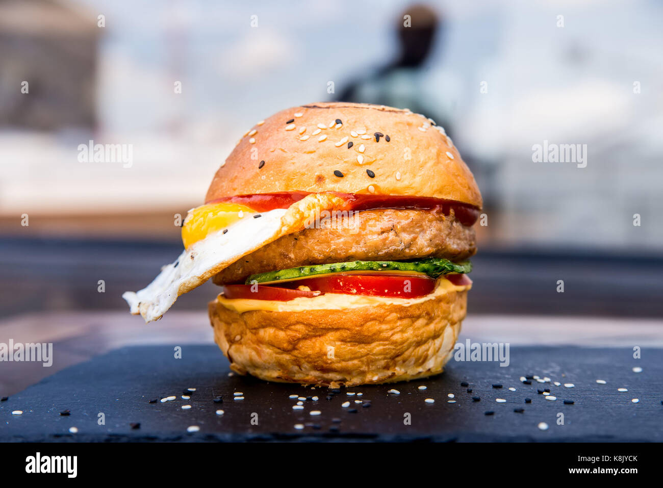 Delicious restaurant hamburger with fried egg - Stock Image