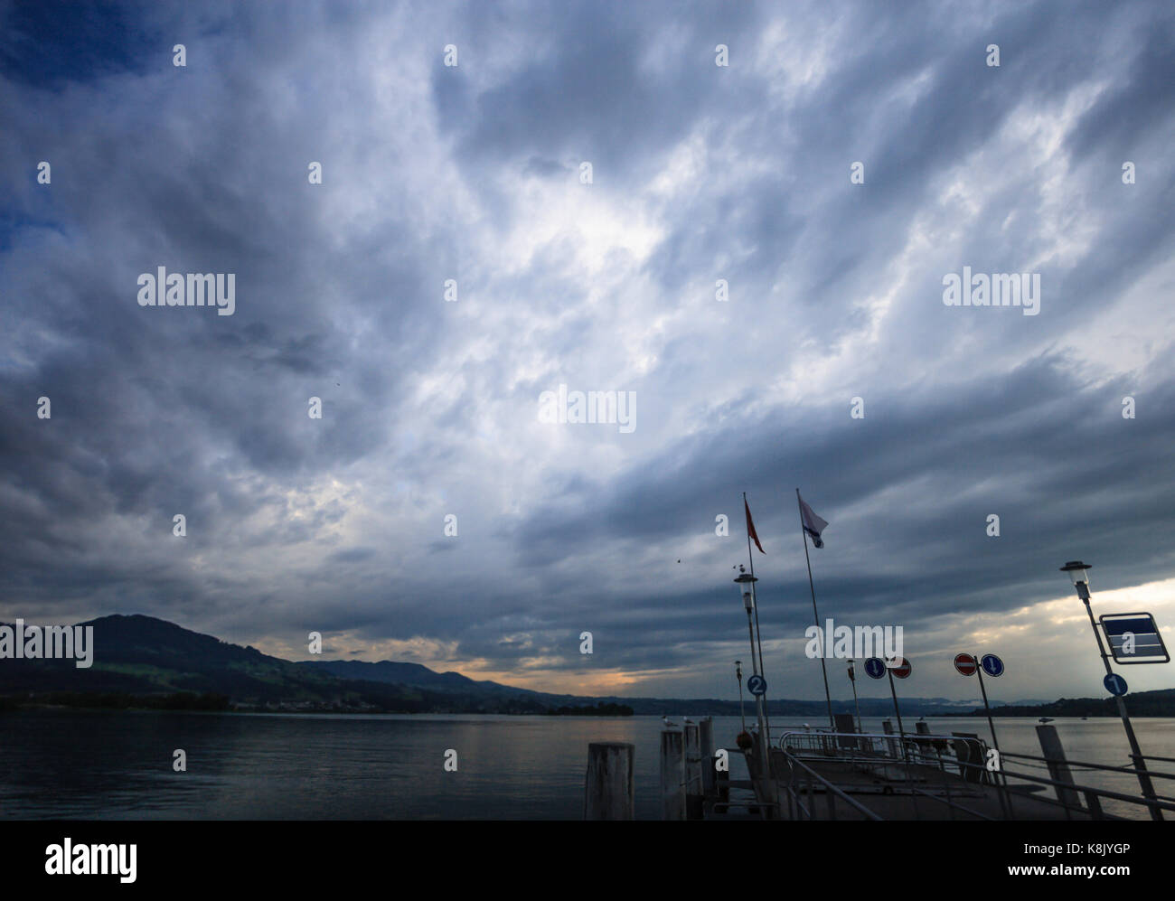 Pier before the rainstorm on the Lake Zurich, Rapperswil, Switzerland, Europe. - Stock Image