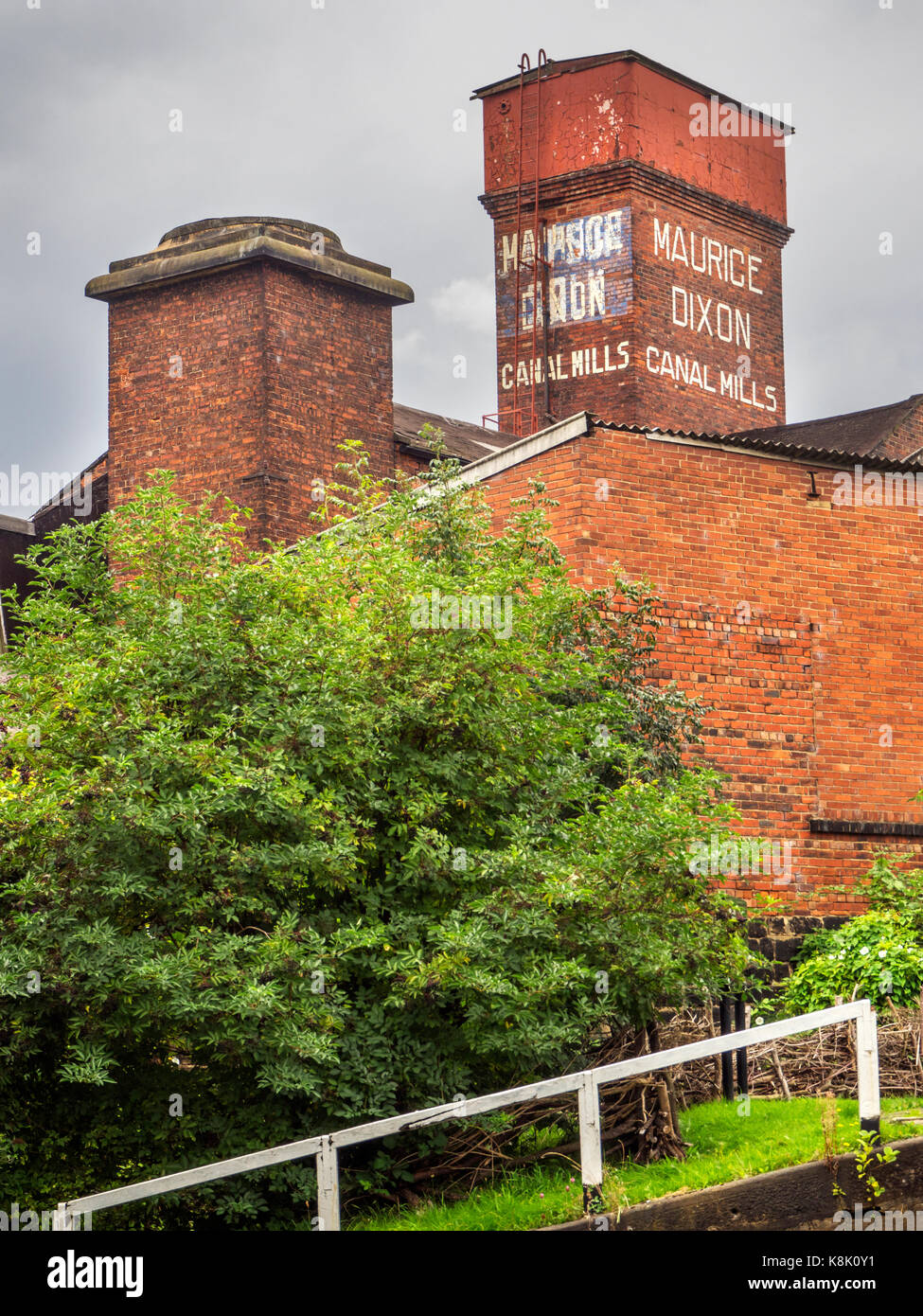 Old Canal Mills Building at Oddy Locks on the Leeds and Liverpool Canal in Leeds West Yorkshire England - Stock Image