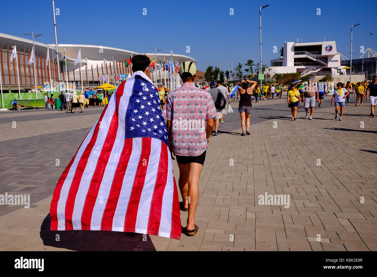 People at the Rio Olympics in 2016 covered with the North american Flag,  cheering for America during the games - Stock Image