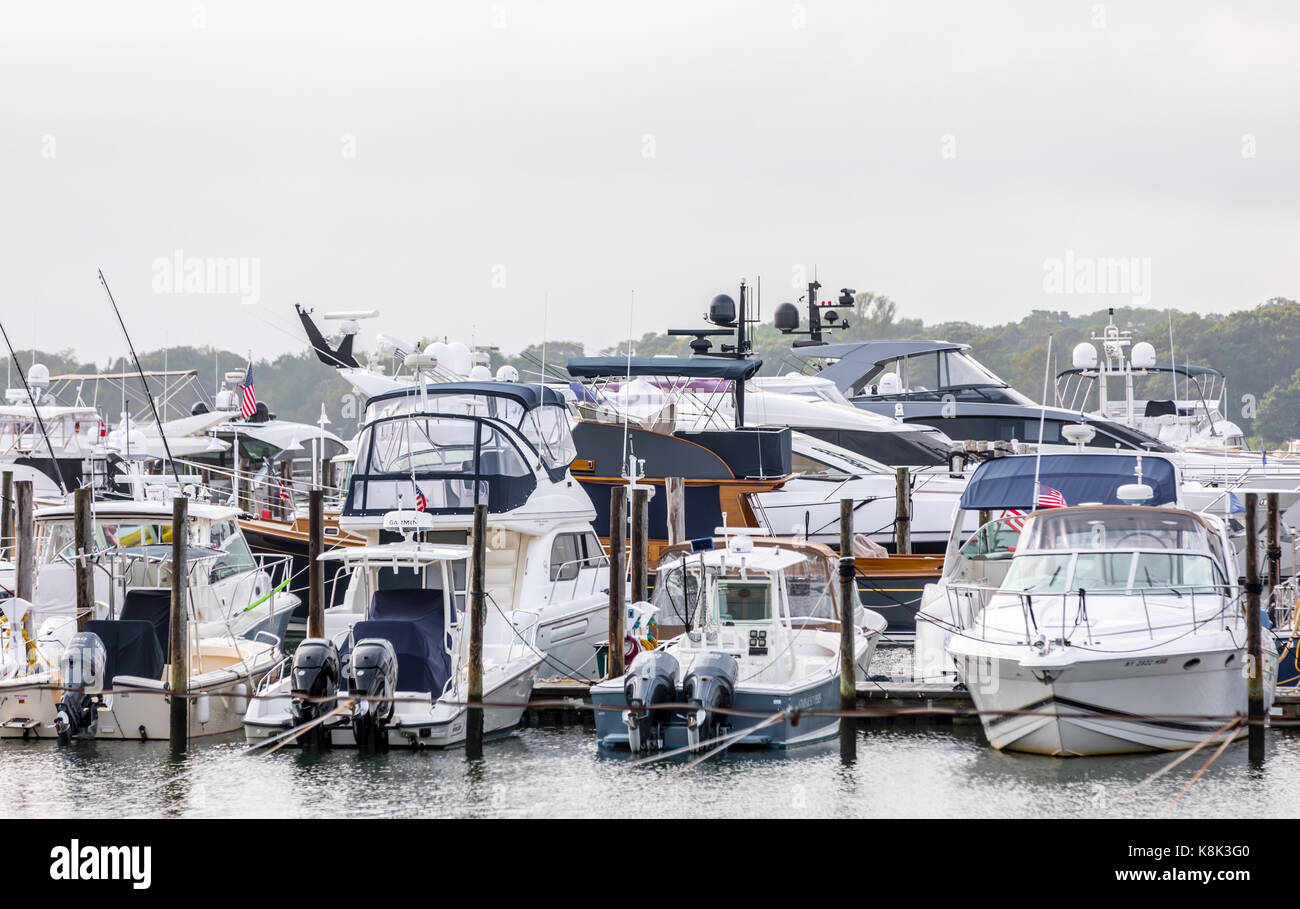 group of various leisure boats at a marina in east hamtpon, ny - Stock Image