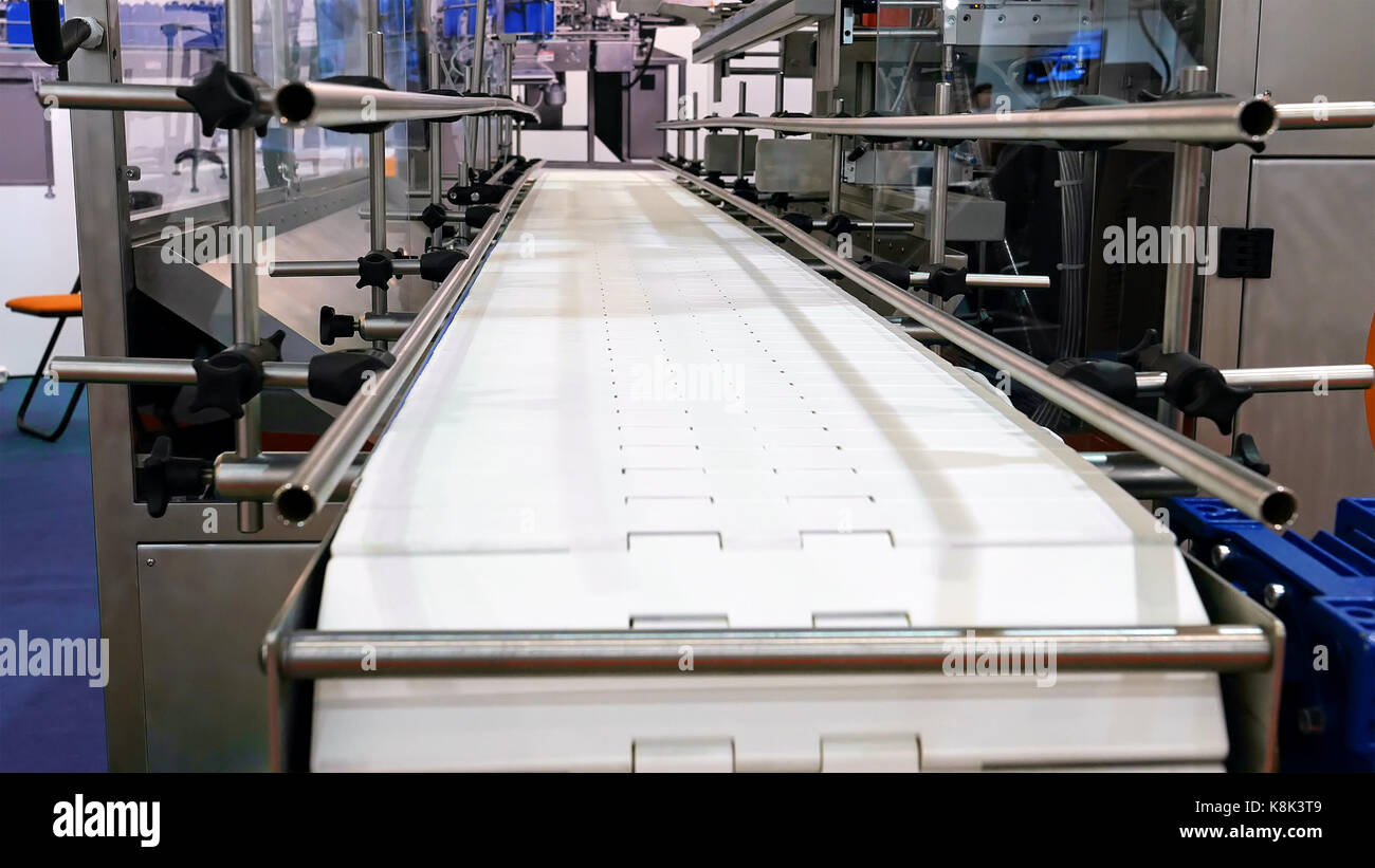 Food factory automated robotic conveyor line - Stock Image