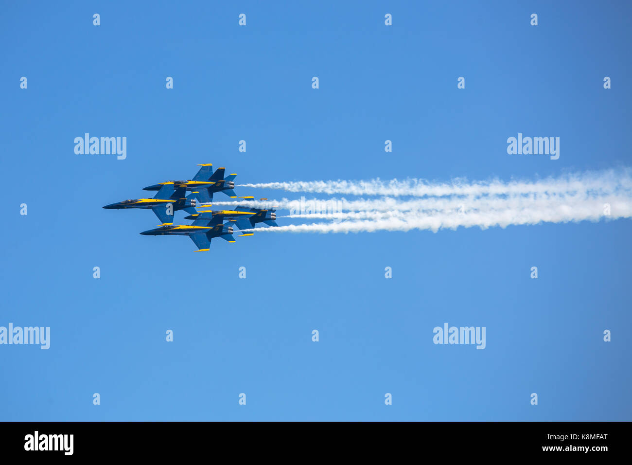 US Navy Blue Angels F/A-18 Hornets flying in formation against a blue sky during the 2017 Chicago Air and Water - Stock Image