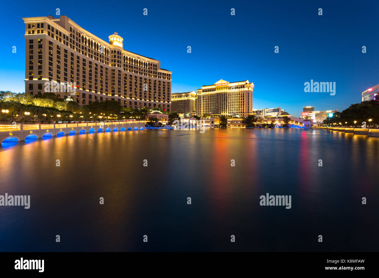 Long exposure of the Bellagio hotel and casino at night against dark blue sky - Las Vegas, NV - Stock Image