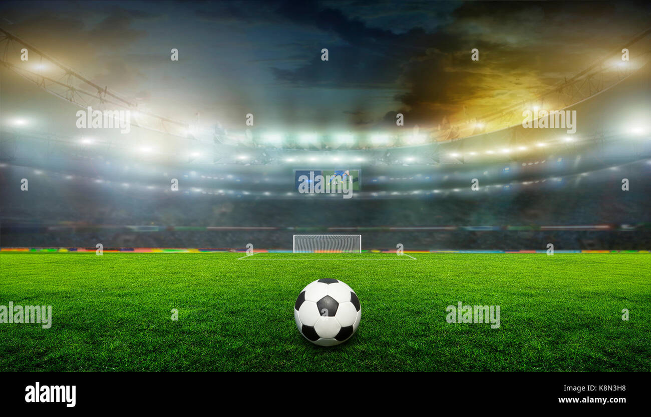 Soccer ball on the field of stadium with light . - Stock Image