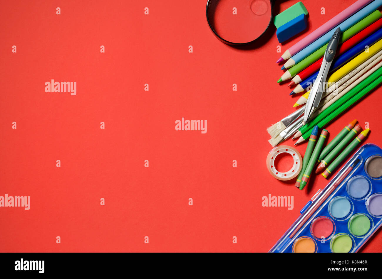School and office stationery, red background, copyspace. stationery office desk top view table school student concept - Stock Image