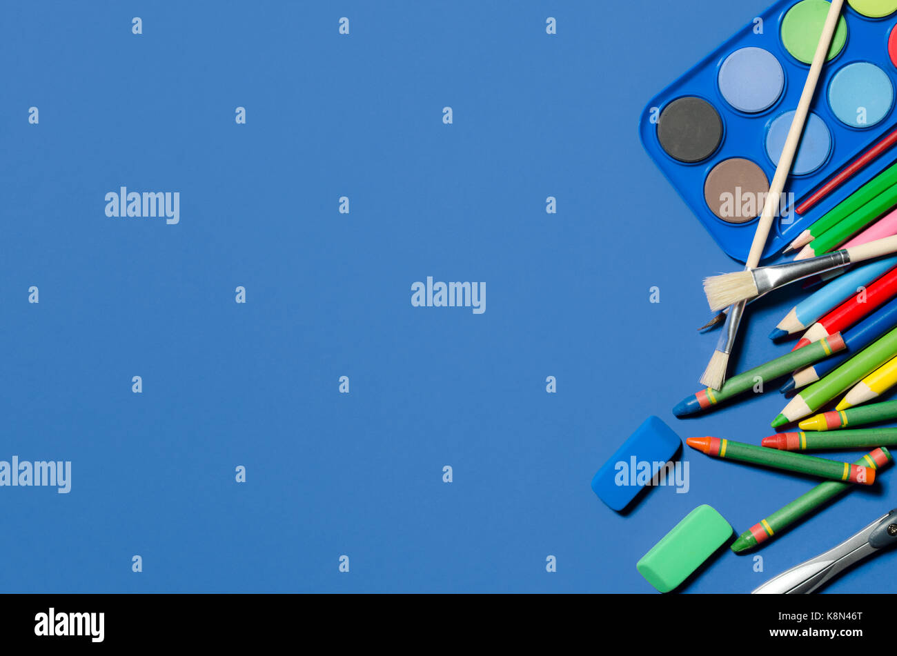 School and office stationery, blue background, copyspace. stationery office desk top view table school student concept - Stock Image