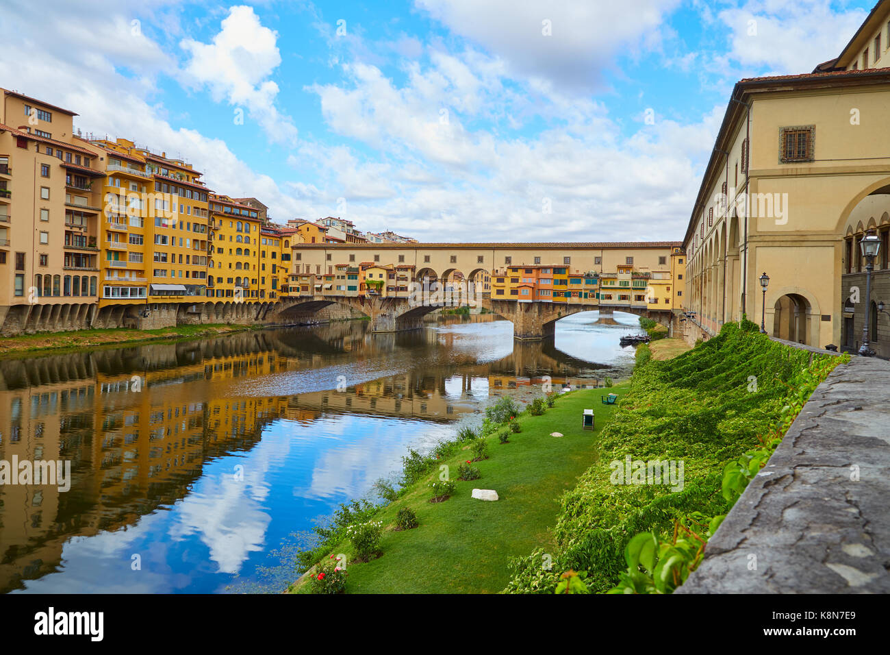 Ponte Vecchio Bridge in a summer sunny day without people - Stock Image