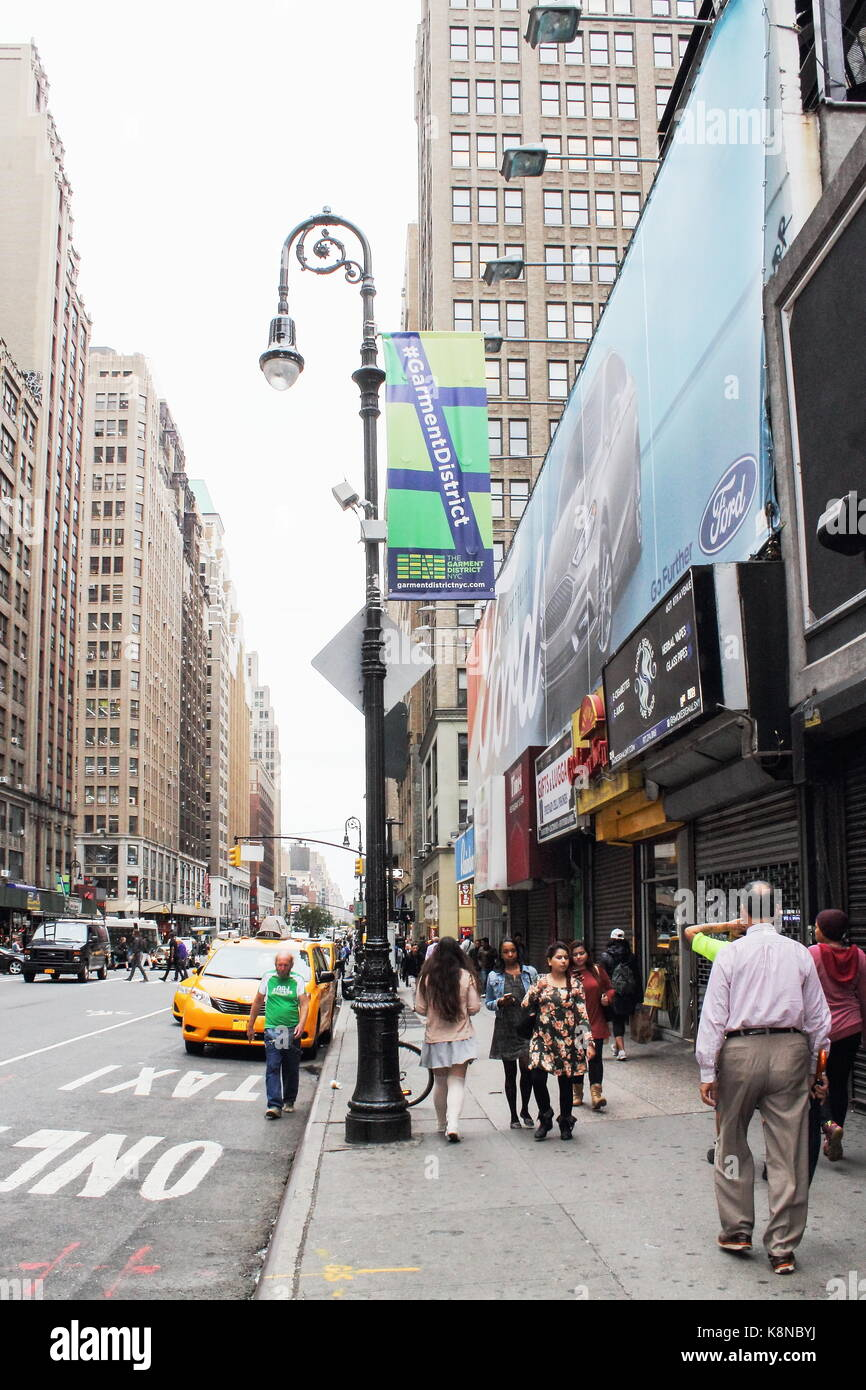 New York, USA -  29 September, 2016: Traffic and Pedestrians on 8th Avenue in Manhattan. Stock Photo