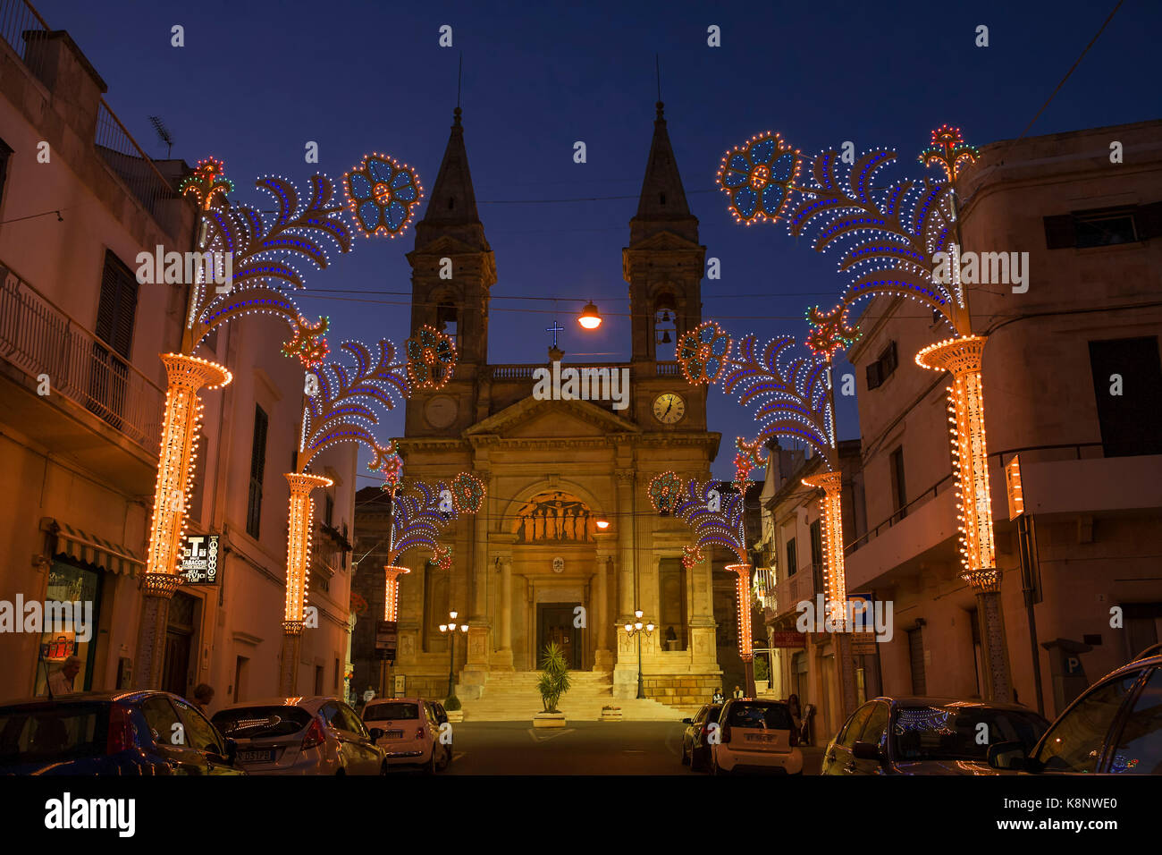The duomo (cathedral) on Piazza Curri in late evening, Alberobello, Puglia - Stock Image