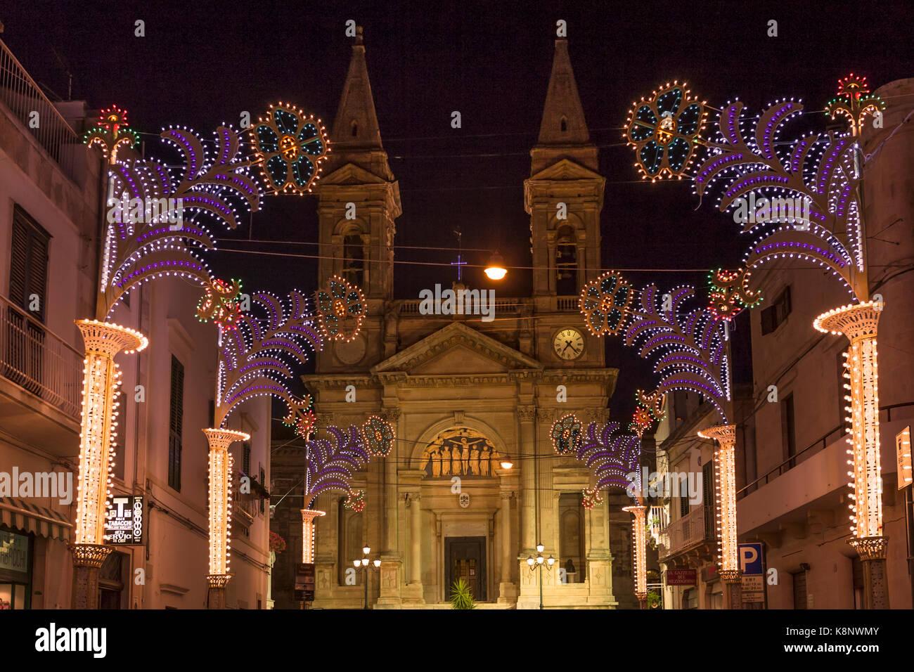 The duomo (cathedral) on Piazza Curri in late evening, Alberobello, Puglia, Italy - Stock Image