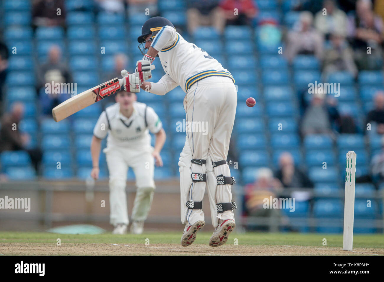 Leeds, UK. 20th Sep, 2017. Jack Leaning (Yorkshire CCC) jumps to play a shot Yorkshire CCC v Warwickshire CCC on - Stock Image