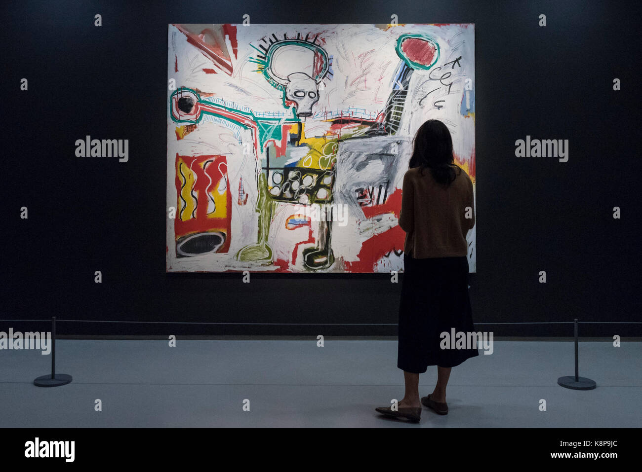 London, UK.  20 September 2017.  A woman views 'Untitled', 1982, by Jean-Michel Basquiat. Preview of 'Basquiat: - Stock Image