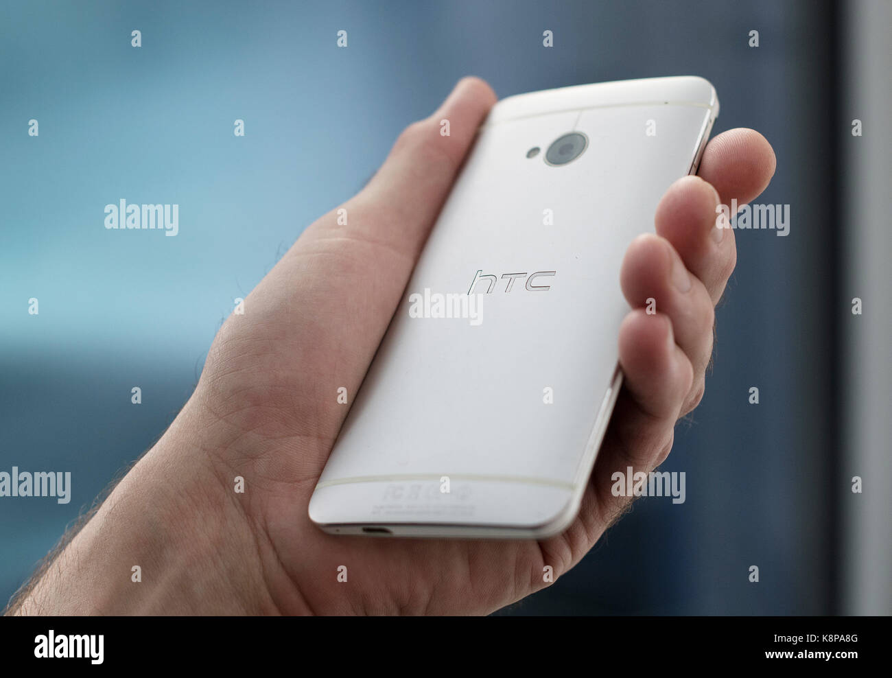 ILLUSTRATION- A hand holding an HTCsmartphone in Berlin, Germany, 20 September 2017. Photo: Fabian Sommer/dpa - Stock Image
