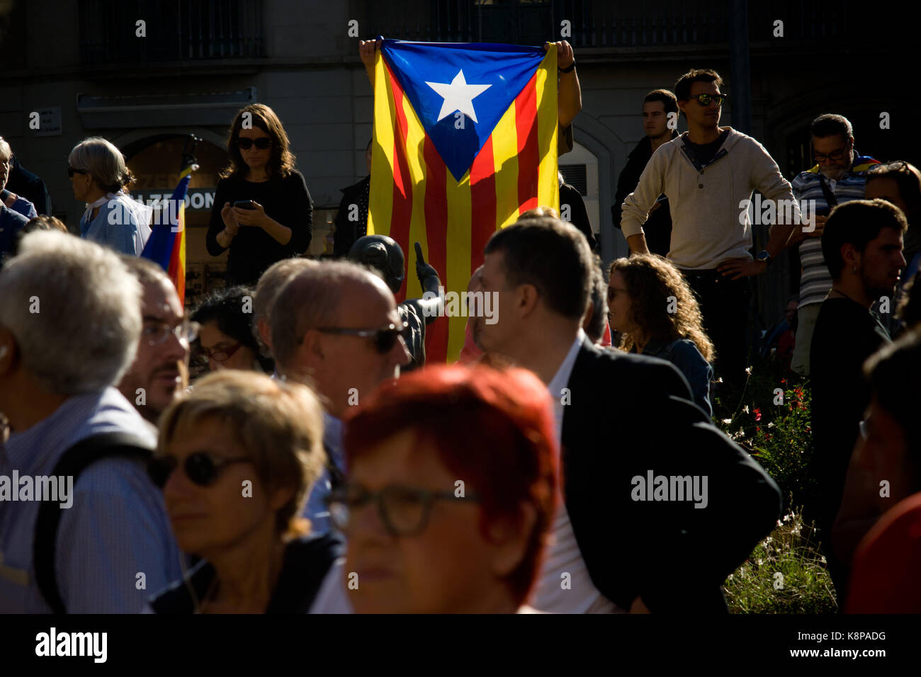 Barcelona, Spain. 20th Sep, 2017. Pro-independence supporters among a estelada flag (sign of Catalonia independence) Stock Photo