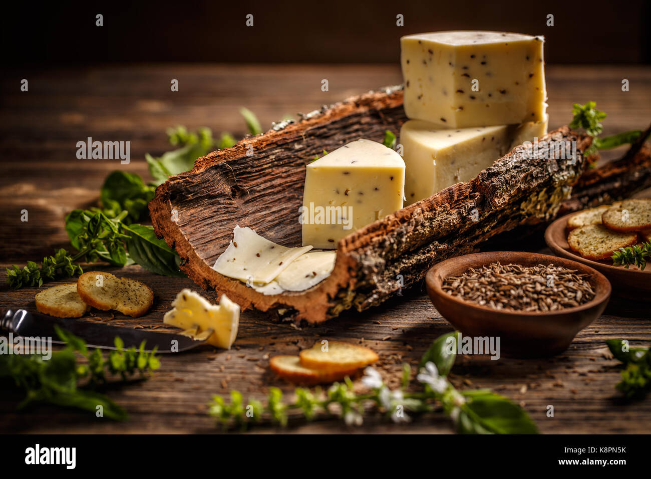 Cheese on a bark with caraway seeds - Stock Image