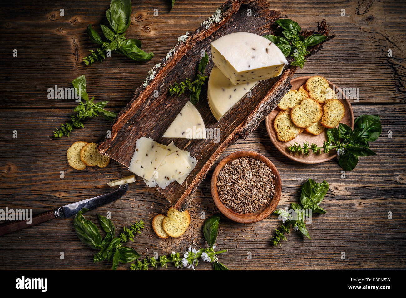 Top view of cheese wedge with caraway seeds - Stock Image