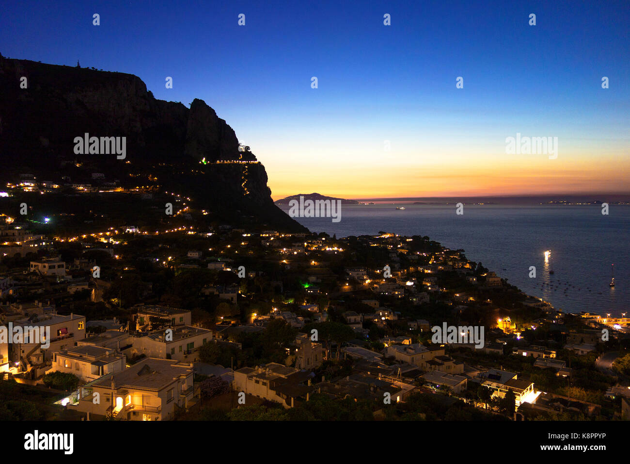 sunset on the island of capri in the bay of naples, italy. - Stock Image